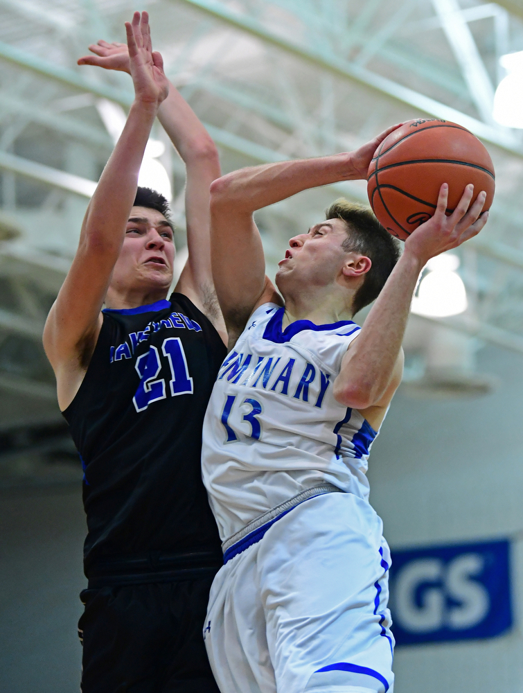 POLAND, OHIO - JANUARY 26, 2018: Poland's Brandon Barringer goes to the basket against Lakeview's Jeff Remmick during the second half of their game on Friday night at Poland High School. DAVID DERMER | THE VINDICATOR