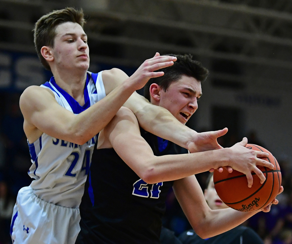 POLAND, OHIO - JANUARY 26, 2018: Lakeview's Jeff Remmick grabs a rebound away from Poland's Billy Orr during the second half of their game on Friday night at Poland High School. DAVID DERMER | THE VINDICATOR