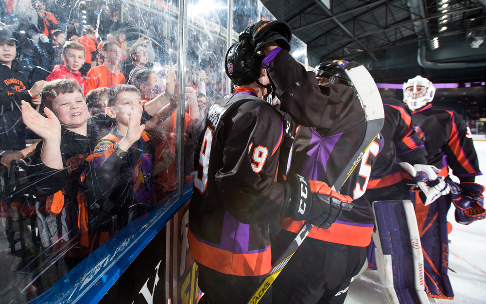 Scott R. Galvin | The Vindicator.The Youngstown Phantoms and fans celebrate Chase Gresock's (19) overtime goal against the Dubuque Fighting Saints at the Covelli Centre on January 27, 2018.