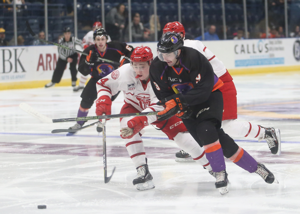 Youngstown Phantoms forward Tommy Parottino (9) pushes past Dubuque Fighting Saints defenseman Josh Maniscalco (24) in the first period of an USHL Hockey game, Sunday, Jan. 28, 2018, in Youngstown. Phantoms won 2-1...(Nikos Frazier | The Vindicator)