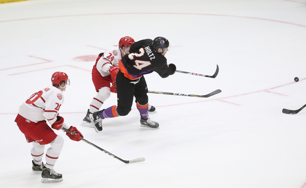 Youngstown Phantoms defenseman Steve Holtz (24) shoots past Dubuque Fighting Saints defenseman Josh Maniscalco (24) in the first period of an USHL Hockey game, Sunday, Jan. 28, 2018, in Youngstown. Phantoms won 2-1...(Nikos Frazier | The Vindicator)