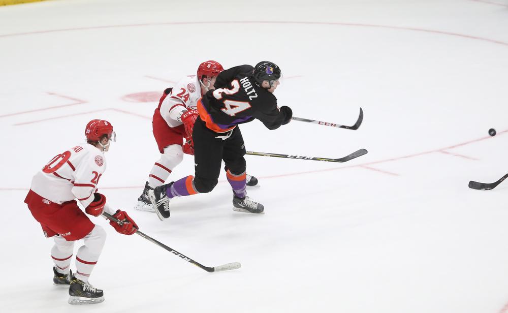 Youngstown Phantoms defenseman Steve Holtz (24) shoots past Dubuque Fighting Saints defenseman Josh Maniscalco (24) in the first period of an USHL Hockey game, Sunday, Jan. 28, 2018, in Youngstown. Phantoms won 2-1...(Nikos Frazier | The Vindicator)