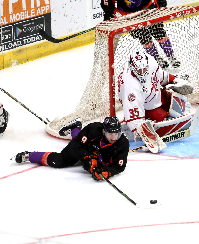 Youngstown Phantoms forward Tommy Parottino (9) attempts to hook the puck past Dubuque Fighting Saints goalie Cole Weaver (35) in the second period of an USHL Hockey game, Sunday, Jan. 28, 2018, in Youngstown. Phantoms won 2-1...(Nikos Frazier | The Vindicator)