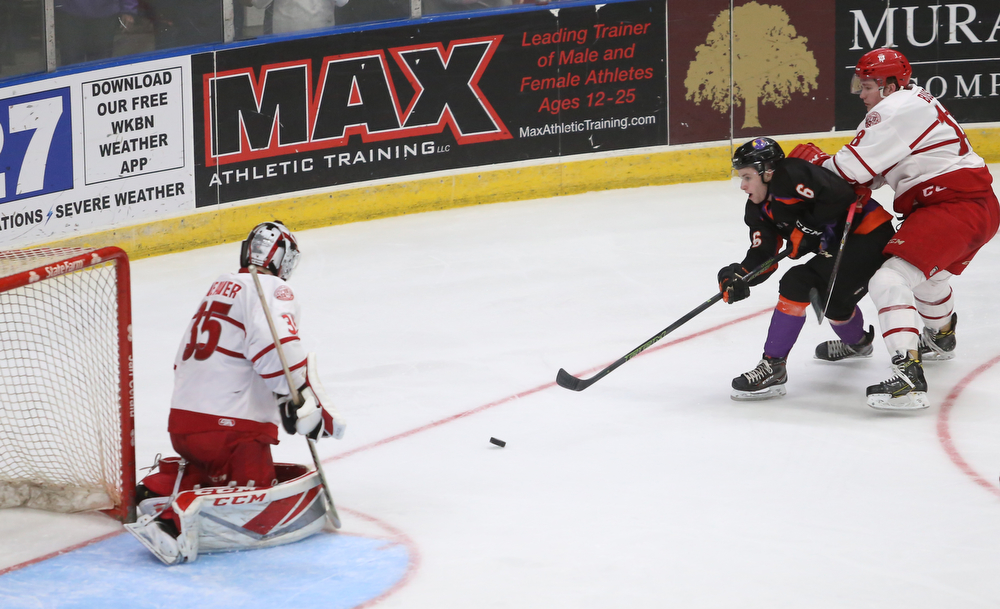 Youngstown Phantoms right wing Max Ellis (6) attempts to score a goal past Dubuque Fighting Saints goalie Cole Weaver (35) in the second period of an USHL Hockey game, Sunday, Jan. 28, 2018, in Youngstown. Phantoms won 2-1...(Nikos Frazier | The Vindicator)