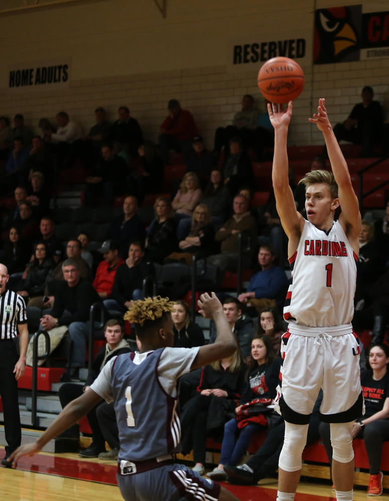 Canfield's forward Aydin Hanousek (1) shoots a three point basket over Boardman guard JaJuantae Young (1) in the fourth quarter of an AAC high school basketball game, Tuesday, Jan. 30, 2018, in Canfield. Canfield won 62-48...(Nikos Frazier | The Vindicator)