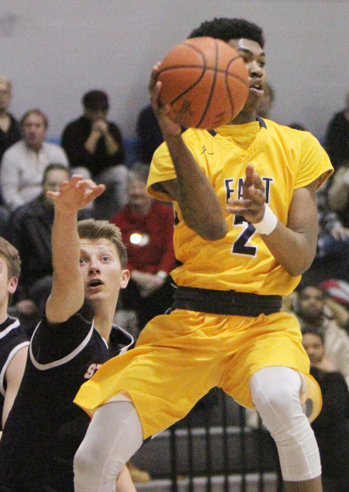 William D. Lewis the Vindicator  Easts Marquel Gillespie(2) passes around Struthers  Carson Ryan (5).
