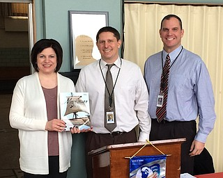 Dave Vecchione, lead principal at Struthers Middle School, was the guest speaker at the recent meeting of the Struthers Rotary Club, hosted by Struthers Schools superintendent and Rotarian Pete Pirone Jr. Vecchione described his childhood in Brownlee Woods and his marriage into the Struthers community through the Barrone family. He worked as an educator and principal in several school districts before moving to Struthers. Above, from left, are Jennifer Johnson, Struthers Rotary Club president; Vecchione; and Pirone. Johnson holds the book that will be donated to the Struthers Elementary School library in Vecchione's name.