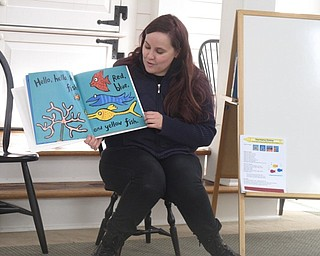 "Neighbors | Zack Shively.Annette Ahrens led the Poland library's ""Baby Brilliant: Tales and Talk for 2s and 3s"" event on Dec. 28. They read books, sang songs and made a craft."