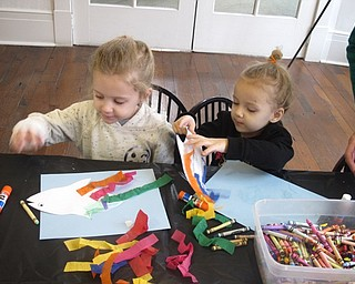 Neighbors | Zack Shively.The craft at the Baby Brilliant program at the Poland library offered children a chance to color and glue. They began with paper outline of a fish to color and decorate. They then glued the outline to a blue sheet of paper to resemble sea. Finally, they added stylish tissue paper to give the fish an interesting looking fin.