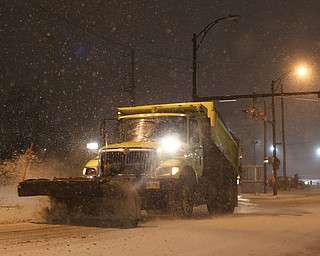 A City of Youngstown snow plow drives eastbound on Front St., Friday, Jan. 12, 2018, in Youngstown...(Nikos Frazier | The Vindicator)