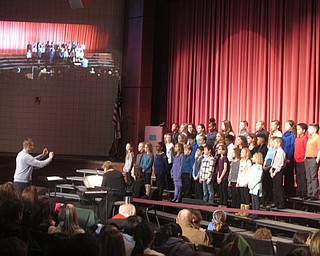 Neighbors | Zack Shively.Boardman schools celebrated their 100th anniversay with a special event centered around their arts program on Jan. 20 at the high school. Pictured, a choir consisting of students from the four elementary schools performed under the direction of Robert Pavalko.