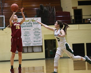 Cardinal Mooney Lauren Frommelt (15) goes up for three as Ursuline's Cara McNally (5) scrambles to try and block her shot in the first quarter of an OSHAA basketball game, Thursday, Feb. 1, 2018, in Youngstown. Ursuline won 76-54...(Nikos Frazier | The Vindicator)