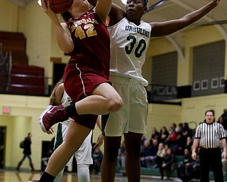 Ursuline's Anyah Curd (30) reaches around to block Cardinal Mooney Conchetta Rinaldi (42)s layup in the first quarter of an OSHAA basketball game, Thursday, Feb. 1, 2018, in Youngstown. Ursuline won 76-54...(Nikos Frazier | The Vindicator)