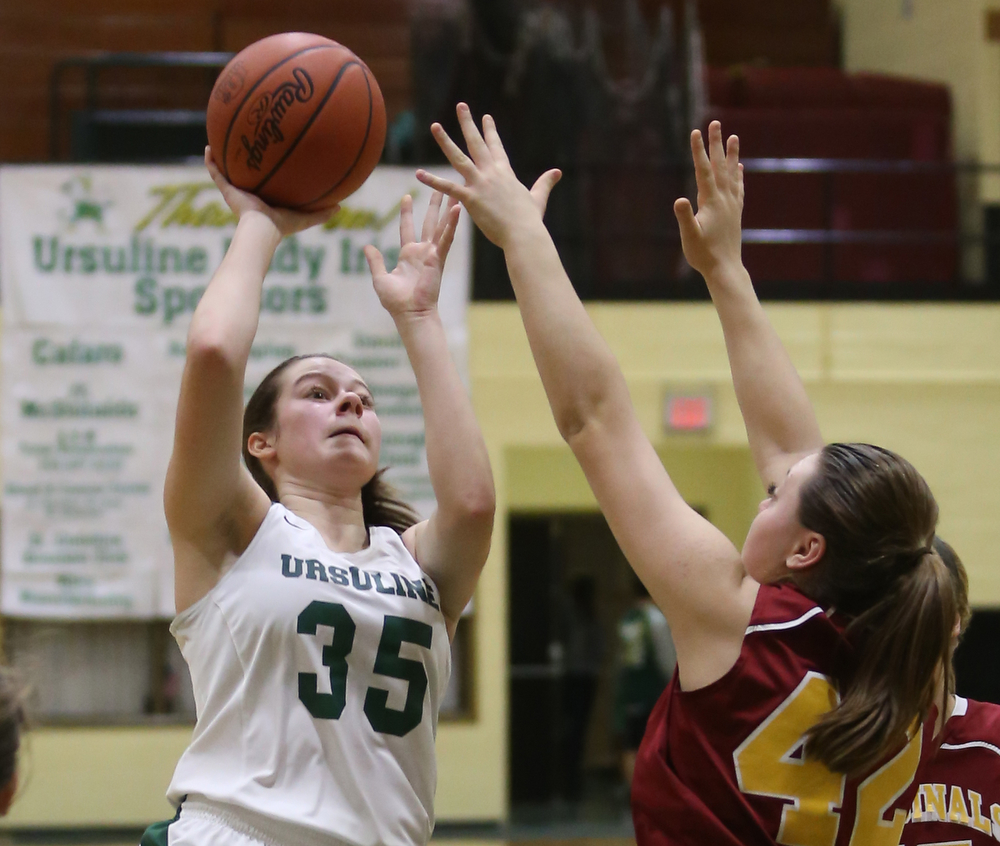 Ursuline's Lindsay Bell (35) puts up two over Cardinal Mooney Conchetta Rinaldi (42) in the third quarter of an OSHAA basketball game, Thursday, Feb. 1, 2018, in Youngstown. Ursuline won 76-54...(Nikos Frazier | The Vindicator)