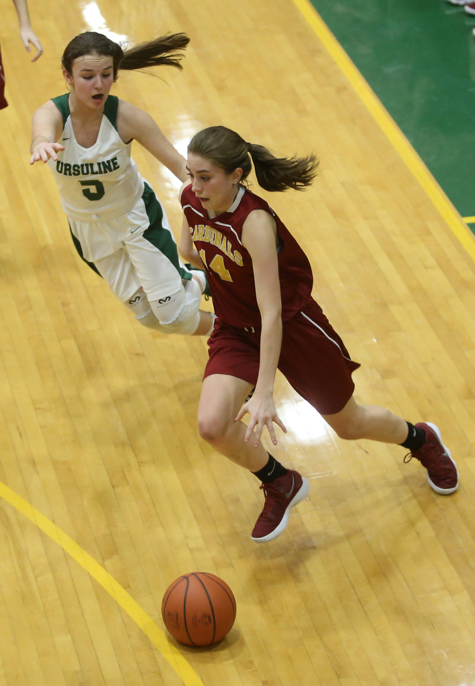 Cardinal Mooney Camden Hergenrather (14) charges to the net with Ursuline's Cara McNally (5) on her tail in the fourth quarter of an OSHAA basketball game, Thursday, Feb. 1, 2018, in Youngstown. Ursuline won 76-54...(Nikos Frazier | The Vindicator)