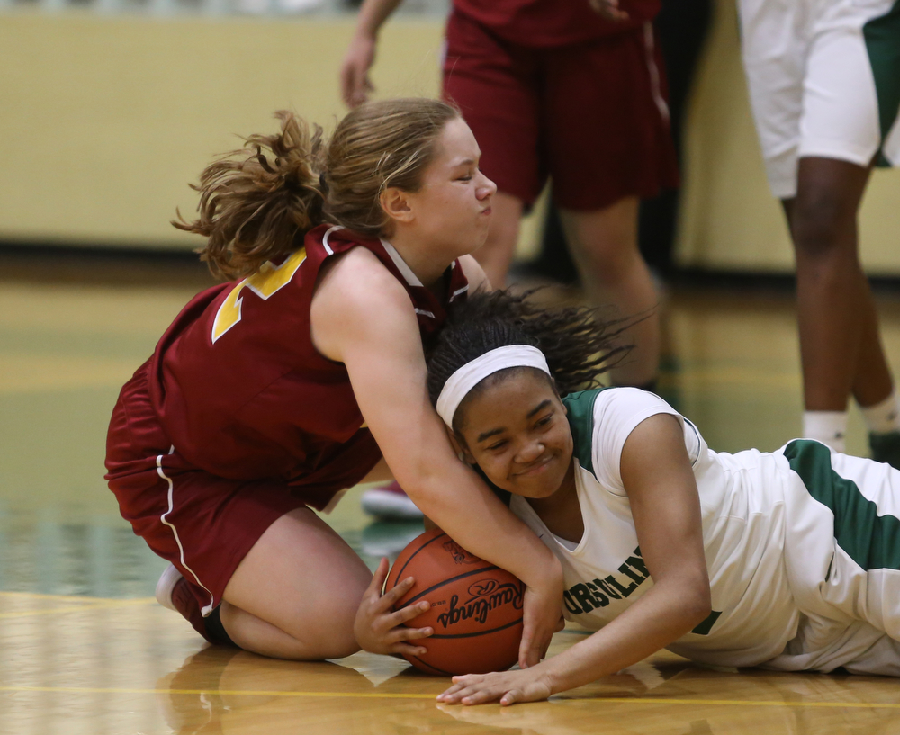 Ursuline's Dayshonette Harris (1) and Cardinal Mooney CJ Sapp (32) fight for the ball in the fourth quarter of an OSHAA basketball game, Thursday, Feb. 1, 2018, in Youngstown. Ursuline won 76-54...(Nikos Frazier | The Vindicator)