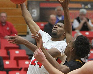 WilliamD. Lewis The Vindicator YSU's Cam More(24) shoots around NKU's Tre Cobbs(3) during 2-1-18 action at YSU.