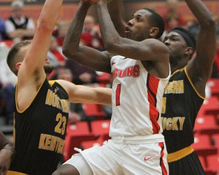 WilliamD. Lewis The Vindicator YSU's Braun Hartfield(1) shoots around NKU's Carson Williams(23) andJordan Garnett(1) during 2-1-18 action at YSU.