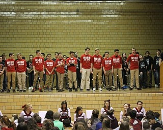Neighbors | Abby Slanker.Canfield Village Middle School seventh-grade boys basketball coach Brady Clark (right) introduced his team at the assembly on Jan. 26.