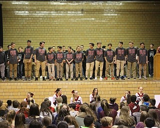 Neighbors | Abby Slanker.Canfield Village Middle School eighth-grade boys basketball coach Mike Yourstowsky (right) introduced his team at the school's annual Winter Sports Pep Assembly on Jan. 26.