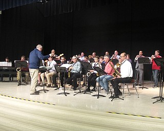 Neighbors | Zack Shively.Austintown Fitch principal Marc Pupino directed the alumni band, which featured graduates from the 70s to recent graduates. Along with Pupino, Austintown choir teacher and drama instructor Bill Klein and band parent president Brad Gessner performed in the band.
