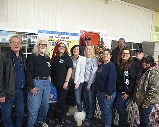 Neighbors | Zack Shively.The Mike Hull Mini Grant Review Committee awarded gifts to six families with autistic children on Dec. 19 at Mahoning Valley Lanes. They also had free bowling and pizza for the families. Pictured are the members of the committee, from left, (front) Jerry Marshall, Joe Kalamann, Melissa Kalamann, Maureen Richendollar, Nancy Hull, Mary Kay Johnson, Bertie Morrissey, Raylenne Rose; (back) John Morrissey, Art Rose and Paul Frondorf. Not pictured are Angelo Hull and Tom Mechlin.
