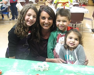 Neighbors | Zack Shively.Families came to Boardman Park to make cookies for Santa on Dec. 20. Pictured are, from left, Ava, Toni, Mia and Mason Acevedio. They rolled out dough and chaped their cookies.