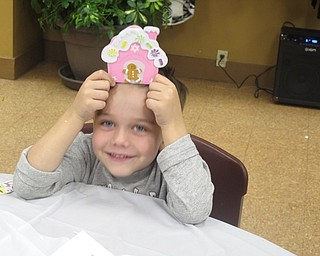 "Neighbors | Zack Shively.The park provided children with crafts during the ""Cookies with Santa"" event. The children decorated a gingerbread man and house. Pictured is Aiden Chizmar with the craft he made."