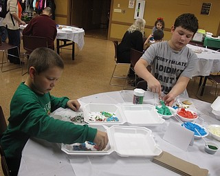 Neighbors | Zack Shively.After the park baked the cookies, families decorated them in sweets, such as icing, sprinkles and candy. Pictured are, from left, Michael and Dylan Short adding a sweetness to their sugar cookies.