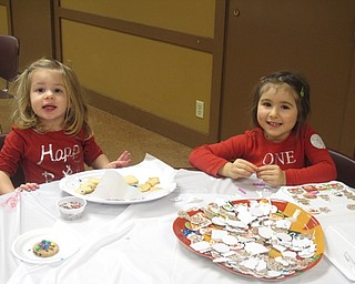Neighbors | Zack Shively.Boardman Park gave the children a box to take their cookies home in. The families could color and put stickers on the box. Pictured are, from left, Skylar Drennen and Sophia Isaacs.