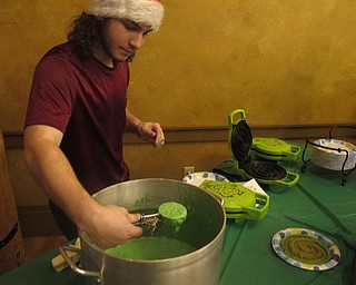 "Neighbors | Zack Shively.Boardman park had a dinner and movie for the families at the ""Cookies for Santa"" night. They served up green Grinch waffles while playing ""Dr. Seuss' How the Grinch Stole Christmas!"""