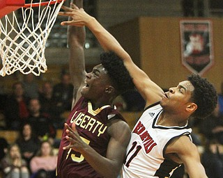 William D. Lewis The Vindicator  Liberty's Ezell Brown(15) goes to the hoop as Campbell's Trae Edwards(11) defends during 2-2-18 action at Campbell