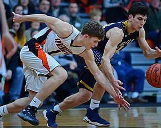NEW MIDDLETOWN, OHIO - FEBRUARY 2, 2018: Lowellville's Joe Ballone reaches for the ball while Springfield's Evan Ohlin attempts to knock the ball away during the first half of their game on Friday night at Springfield High School. DAVID DERMER | THE VINDICATOR