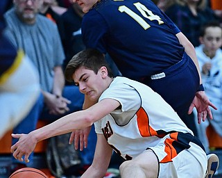 NEW MIDDLETOWN, OHIO - FEBRUARY 2, 2018: Springfield's Drew Clark reaches for the ball while being pressured by Lowellville's Matt Hvisdak during the first half of their game on Friday night at Springfield High School. DAVID DERMER | THE VINDICATOR
