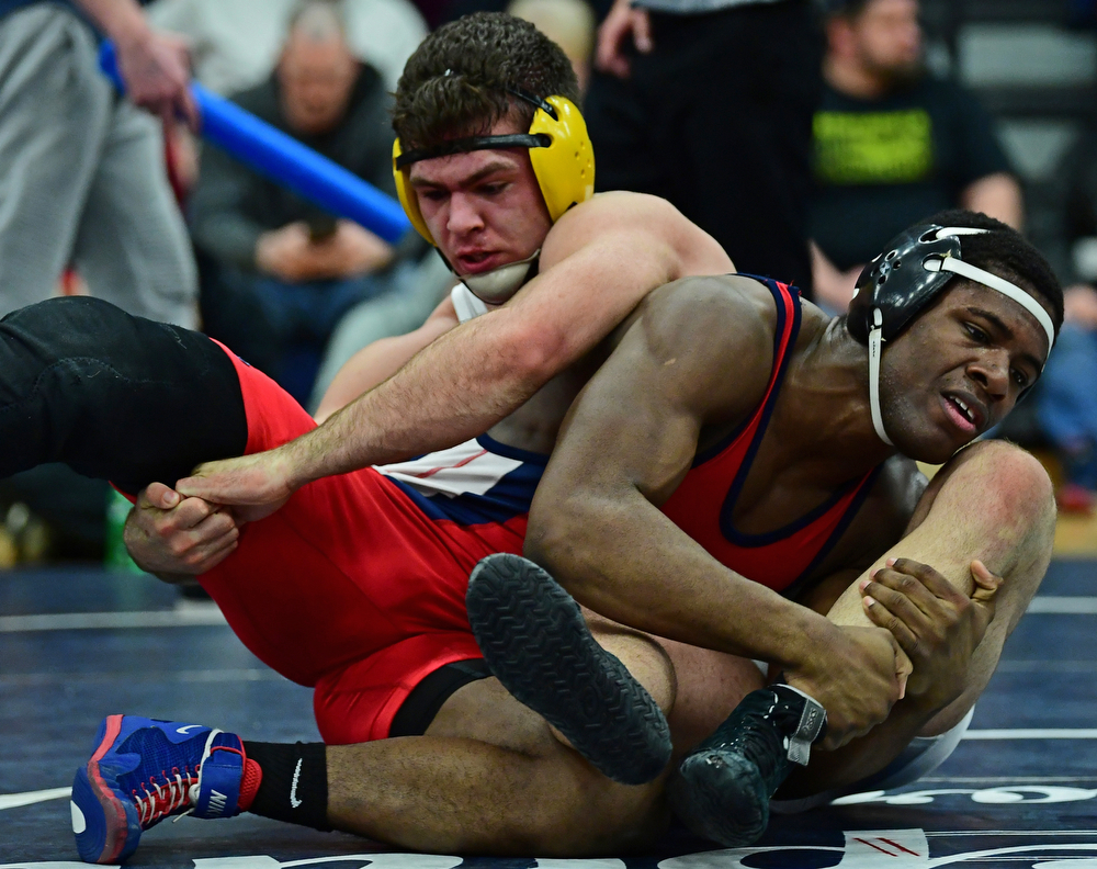 AUSTINTOWN, OHIO - FEBRUARY 3, 2018: Fitch's Breylon Douglas attempts to break free from Crestview's Landon Talbert during their 195lb EOWL Championship bout, Saturday night at Austintown Fitch High School. DAVID DERMER | THE VINDICATOR