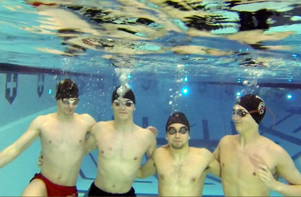 William D. Lewis The Vindicator  Boardman swimming relay team poses for a portrait under water at YSU. From left: Callen Aulizia, Kyle Kimerer, Noah Basista and Matt Dunlany.