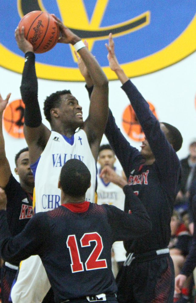 William D Lewis The Vindicator  VCS Milan Square(5) shoots over JFk's Byron Taylor(12) and Tyler James (5).