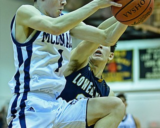 McDONALD, OHIO - FEBRUARY 6, 2018: McDonald's Zach Rasile grabs a rebound away from Lowellville's Joe Ballone during the first half of their game on Tuesday night at McDonald High School. DAVID DERMER | THE VINDICATOR