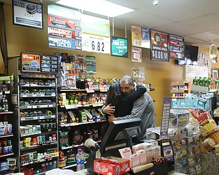 Fidaa Musleh hugs XXXX goodbye before departing for Cleveland Hopkins International Airport, Wednesday, Feb. 7, 2018, at the Downtown Circle Convenience and Deli in Youngstown. ..(Nikos Frazier   The Vindicator)