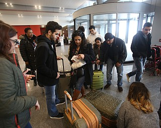Fidaa Musleh(center) navigates her luggage to stuff a few last minute items in any space available, Wednesday, Feb. 7, 2018, at Cleveland Hopkins International Airport in Cleveland. ..(Nikos Frazier | The Vindicator)