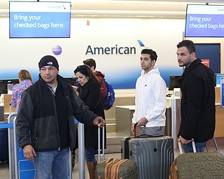 Fidaa Musleh(center) checks into her American Airlines flight, Wednesday, Feb. 7, 2018, at Cleveland Hopkins International Airport in Cleveland. ..(Nikos Frazier   The Vindicator)