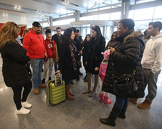 Fidaa Musleh says goodbye to her family, Wednesday, Feb. 7, 2018, at Cleveland Hopkins International Airport in Cleveland. ..(Nikos Frazier | The Vindicator)