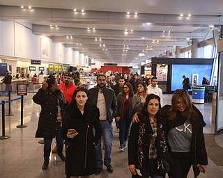 Fidaa Musleh(center), walks with Rana Addullah(right) and Amal Saleh with her family in tow, Wednesday, Feb. 7, 2018, at Cleveland Hopkins International Airport in Cleveland. ..(Nikos Frazier | The Vindicator)