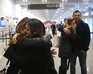 Fidaa Mushleh(back) hugs Gina Musleh goodbye before departing for her flight to reunite with her husband, Al Adi in Amman, Jordan, Wednesday, Feb. 7, 2018, at Cleveland Hopkins International Airport in Cleveland. Adi was deported to Jordan last week after 13 days in ICE detainment...(Nikos Frazier | The Vindicator)