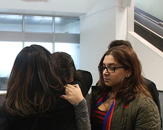 Fidaa Musleh(left) hugs her daughters, Lina(center) Adi goodbye before departing for her flight to reunite with her husband, Al Adi in Amman, Jordan, Wednesday, Feb. 7, 2018, at Cleveland Hopkins International Airport in Cleveland. Adi was deported to Jordan last week after 13 days in ICE detainment...(Nikos Frazier   The Vindicator)