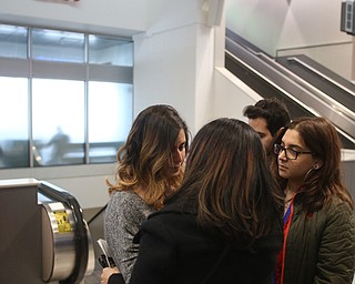Fidaa Musleh(left) hugs her daughters, Lina(center) and Rania Adi goodbye before departing for her flight to reunite with her husband, Al Adi in Amman, Jordan, Wednesday, Feb. 7, 2018, at Cleveland Hopkins International Airport in Cleveland. Adi was deported to Jordan last week after 13 days in ICE detainment...(Nikos Frazier | The Vindicator)