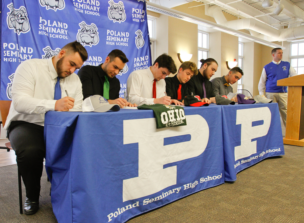 ROBERT K.YOSAY  | THE VINDICATOR..Poland Signing Day.. as 6 players from the class of 2018 head off to college ball..L-R   Nick Sabrin - Dante Ruozzo- Jonah Spencer - Mike Diaz Drew Davies and Cole Lavorini at podium is Brian Banfield......-30-