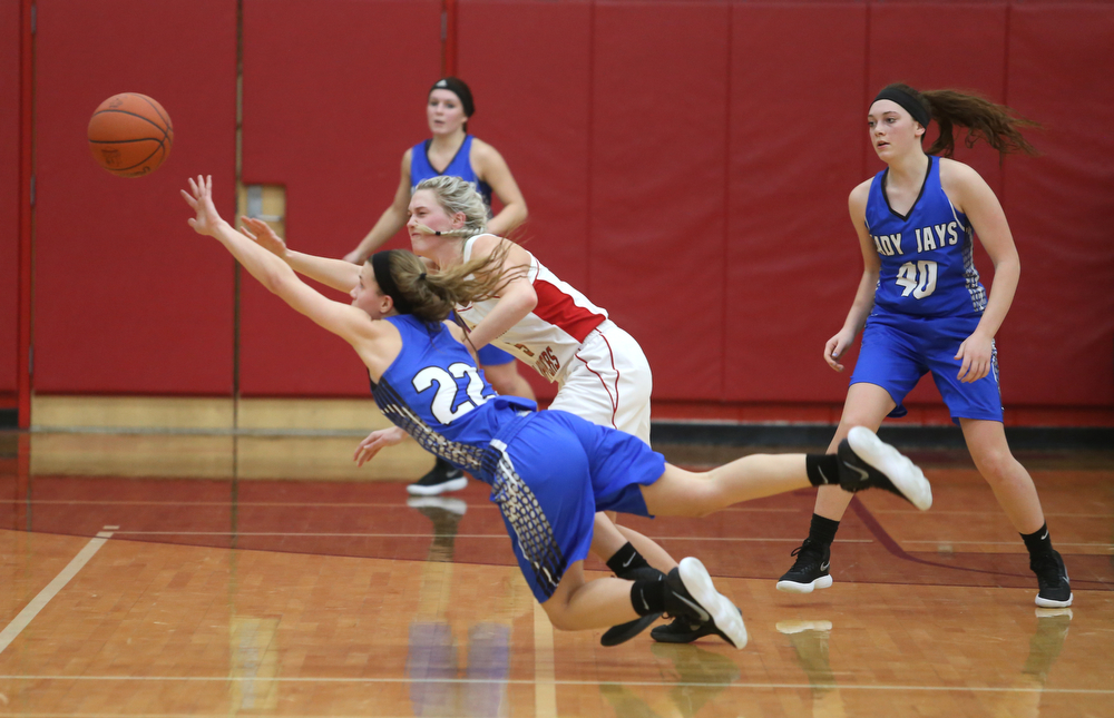 Jackson-Milton guard Michaelina Terranova (22) and Columbiana's Tessa Liggett (5) jump out for the loose ball in the fourth quarter of an OHSAA high school basketball game, Thursday, Feb. 8, 2018, in Columbiana. Columbiana won 36-23...(Nikos Frazier | The Vindicator)