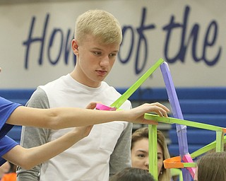 ROBERT K.YOSAY  | THE VINDICATOR..making the marble paper roller coasters - Isaiah Vennetti and Chris Black both 9th graders..A few hundred Hubbard High School students spent Friday at the schoolÕs STEM Festival where they put their creativity and STEM knowledge to the test. Students could choose to participate in contests including bridge building, creating and testing a trebuchet and an egg drop...-30-