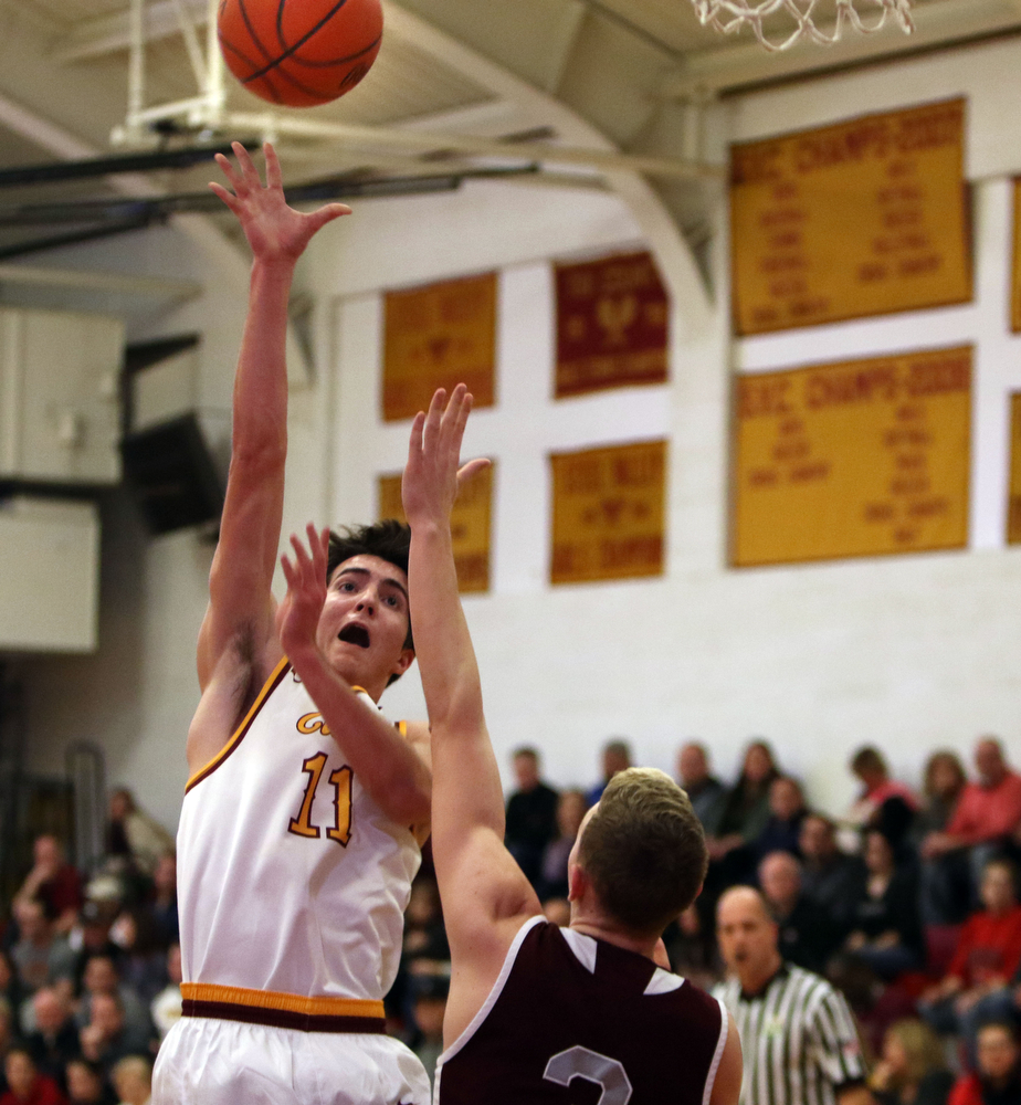 ROBERT  K. YOSAY | THE VINDICATOR..Boardmn at Cardinal Mooney ..Mooney #11 Anthony Fire up and over   #3 Holden Lipke during first quarter action at Mooney